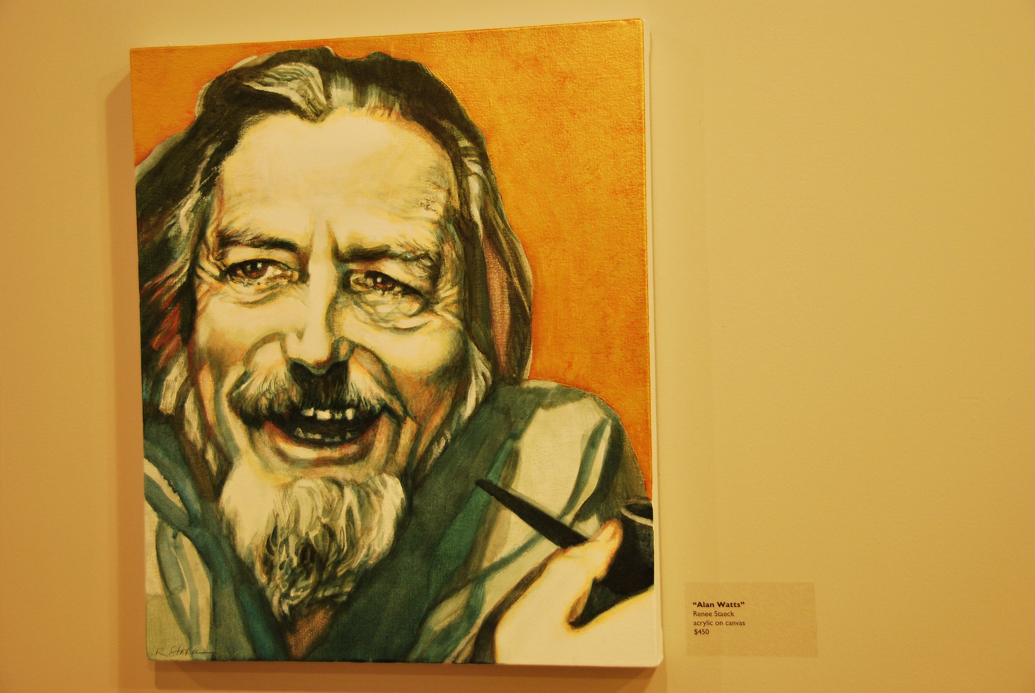 A Painting of the philosopher Alan Watts on a gallery wall