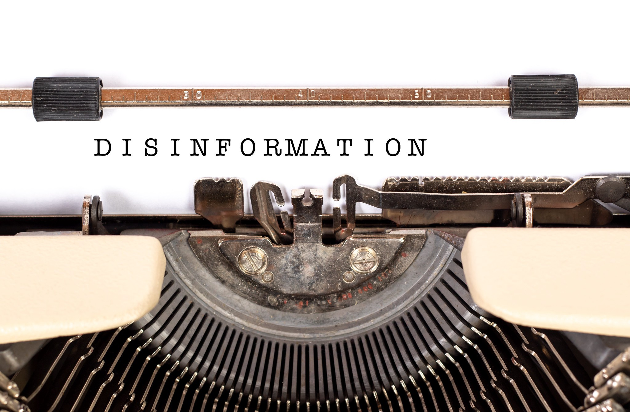 An antique typewriter with a piece of paper that says disinformation. Credit: Marco Verch/trendingtopics