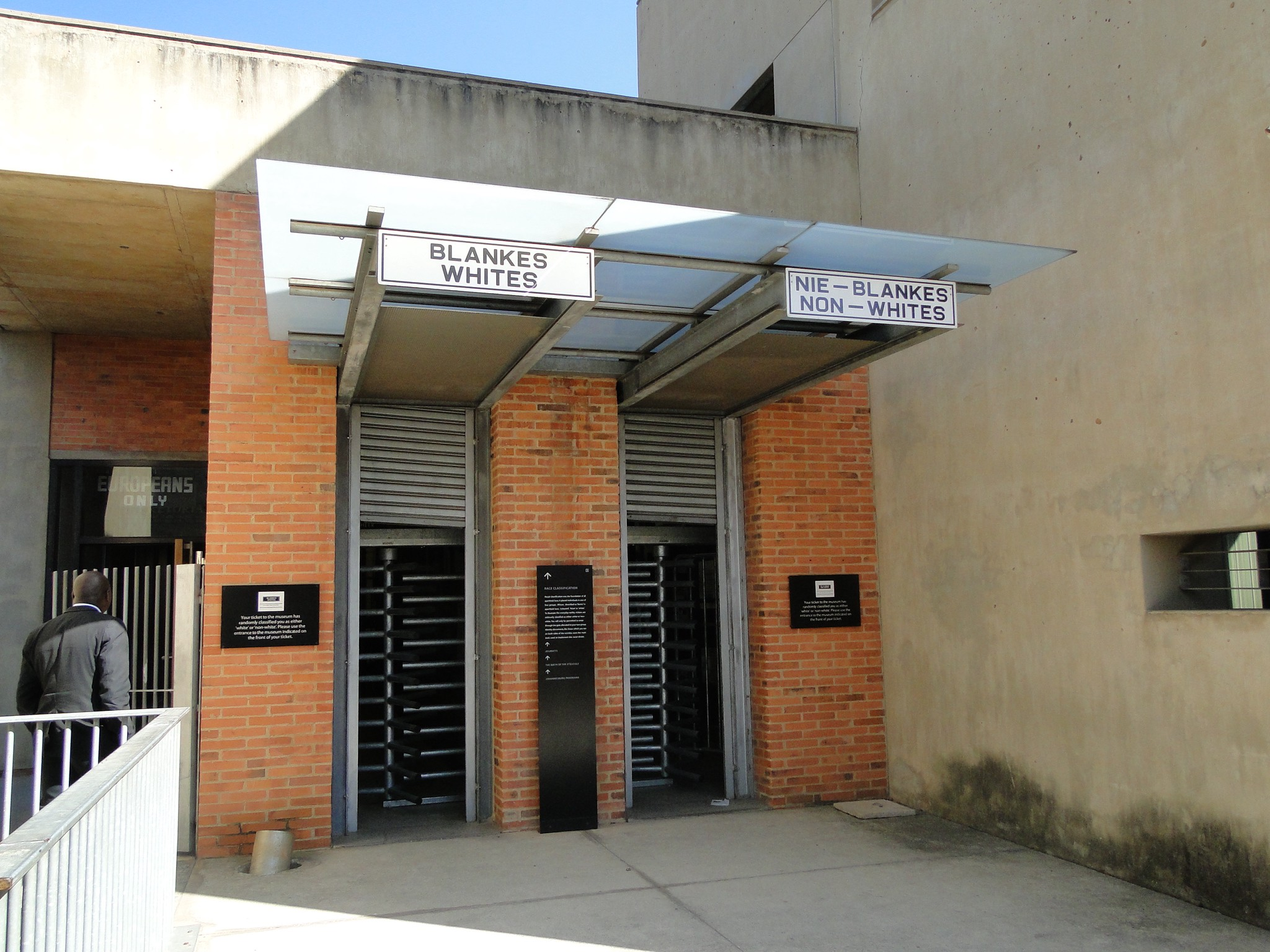 Separate entrances for Blacks and whites at the Apartheid Museum. Photo by Karla J. Strand. All rights reserved.