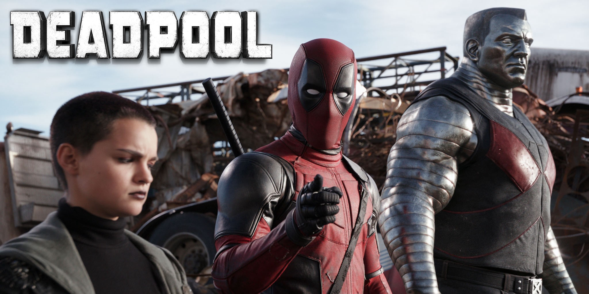 Standing left to right, the characters Negasonic Teenage Warhead, Deadpool, and Colossus. Deadpool points at the audience.