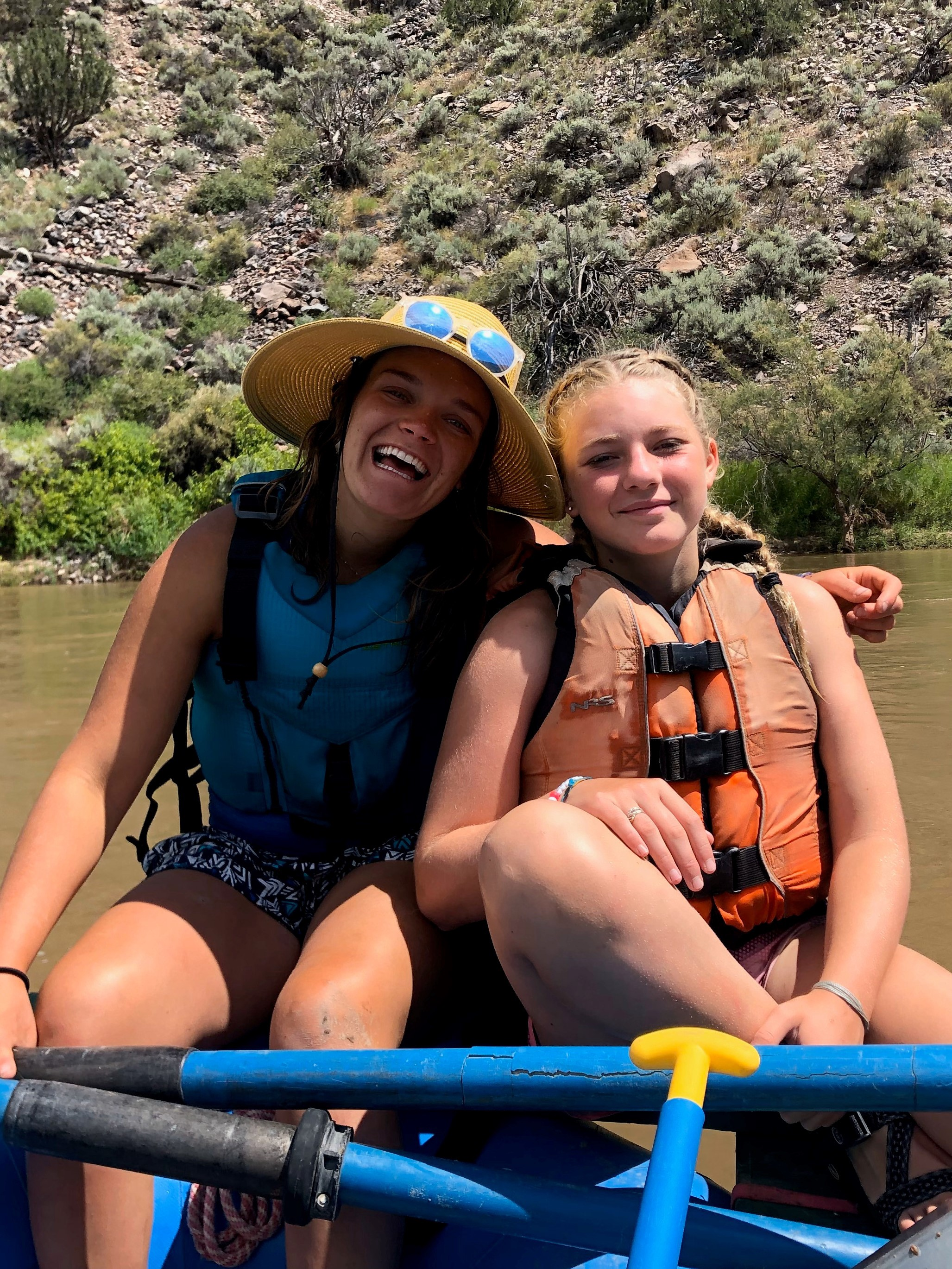 2 young women in a canoe