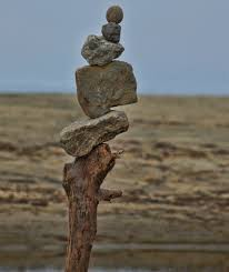 Stack of small stones on beach.