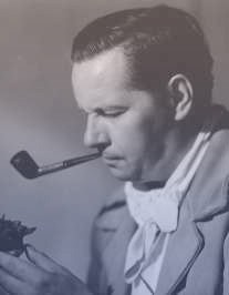 Boleslavsky in profile, with short dark hair and a pipe in his mouth.