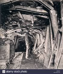 A mine shaft in the West Virginia Coal Mines supported by timber, branches and anything within easy reach