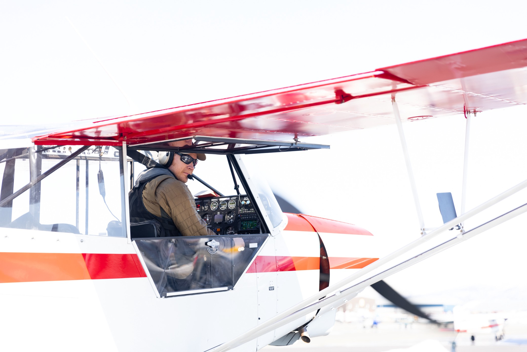 Man in a small plane looking out