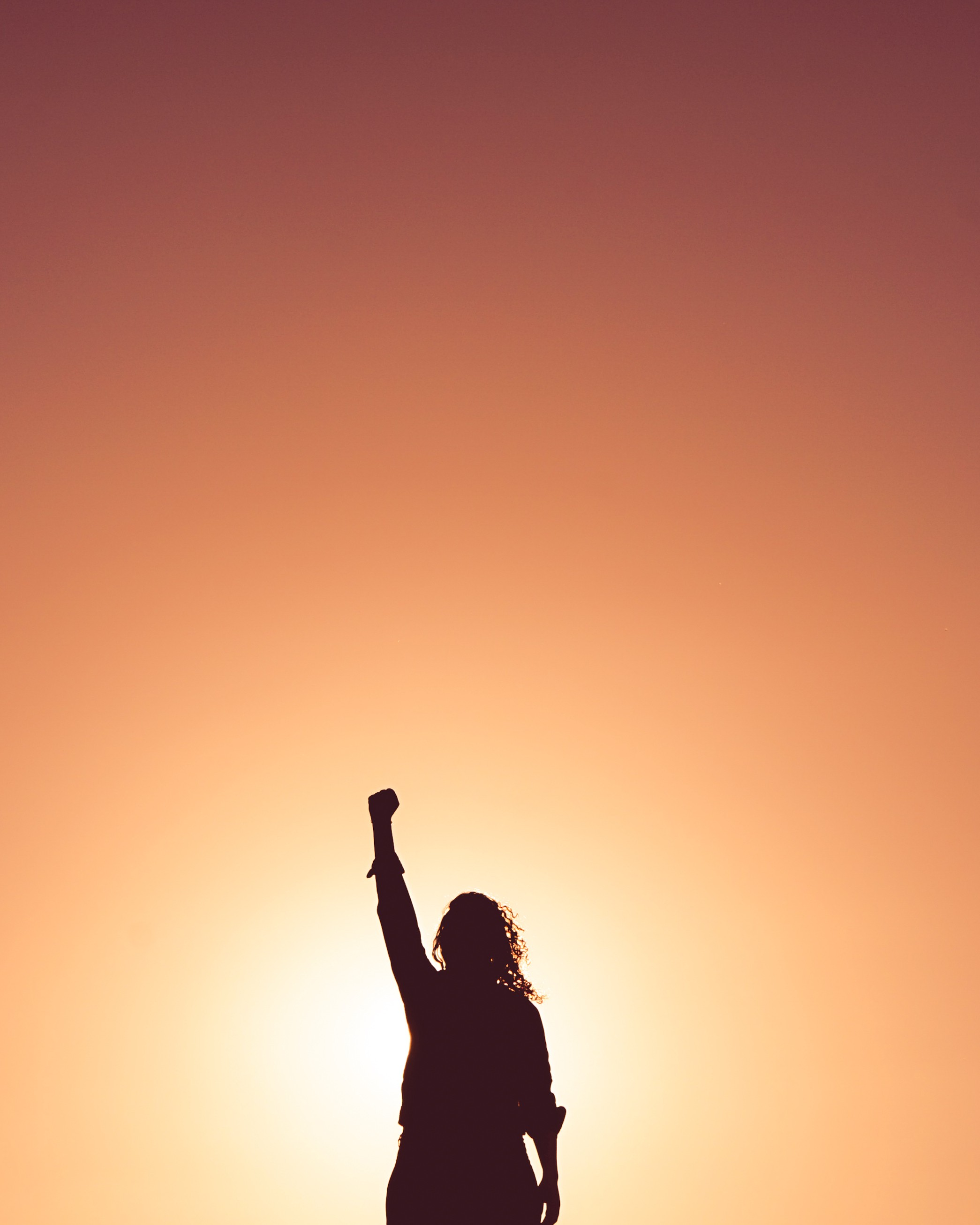 motivational image of woman with fist raised