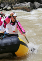 Woman in a raft in white water