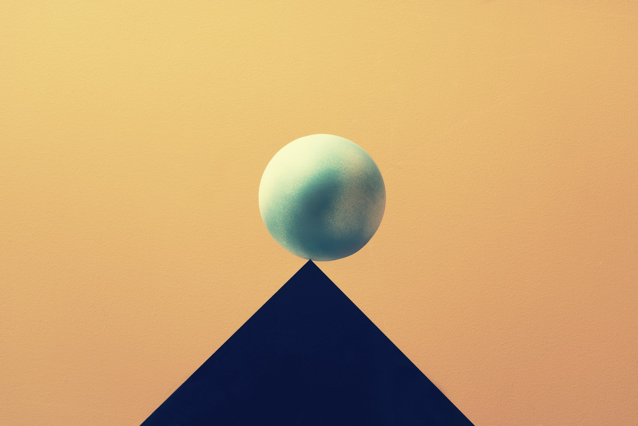 An illustration of the Earth balancing on a triangular peak, tilting toward one side