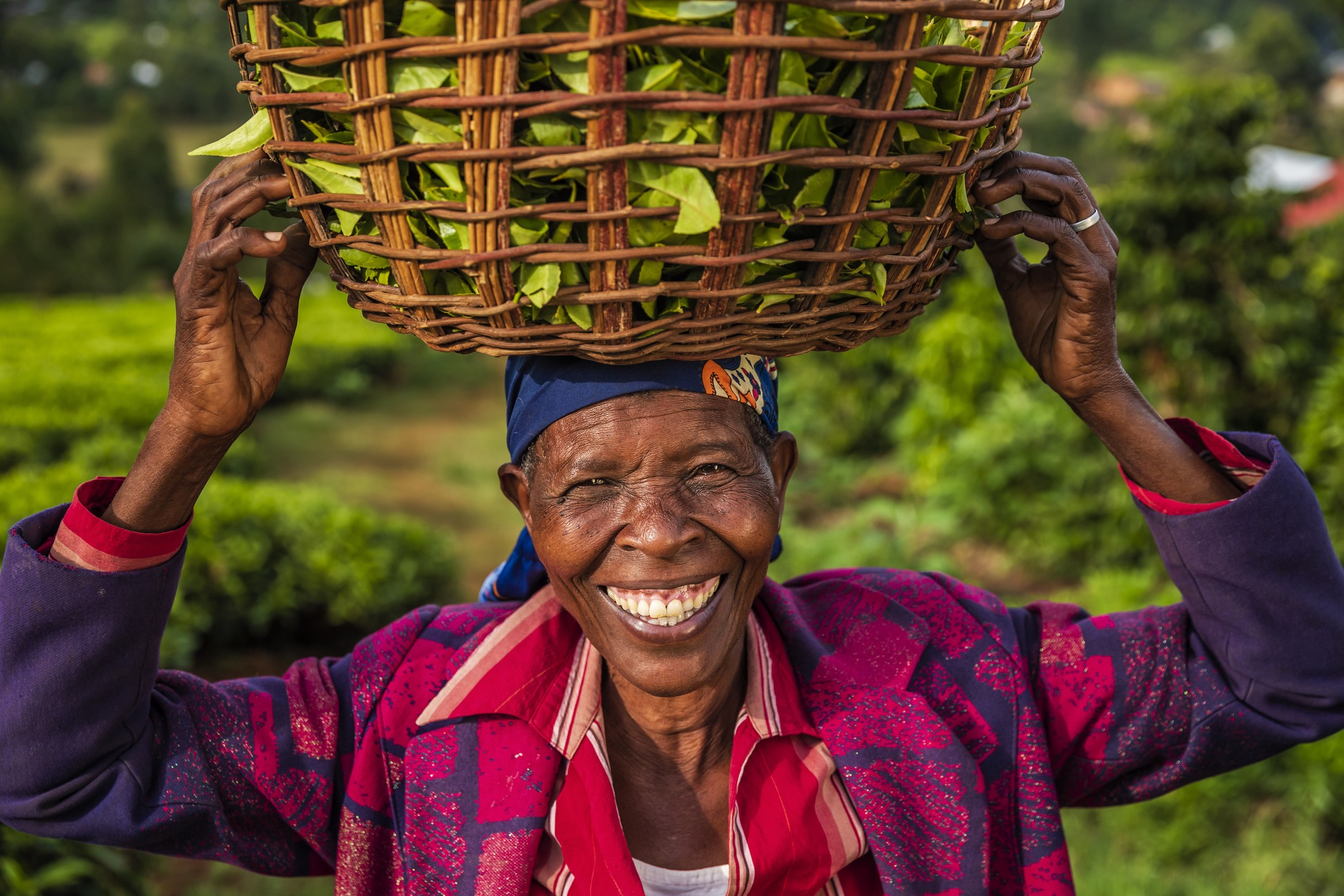 Woman smiling holding basket of crops