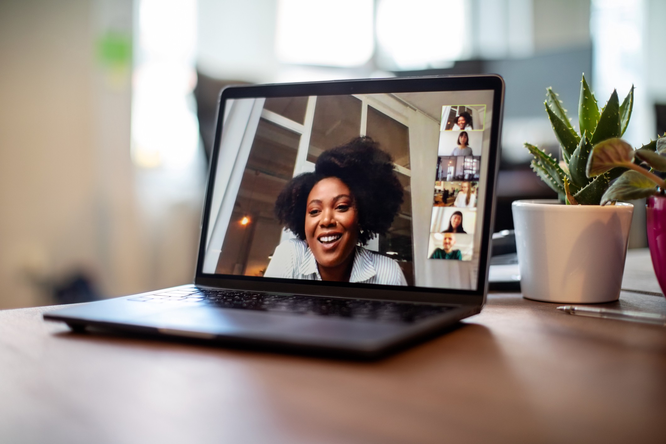 Businesswoman having a video call meeting with her team.