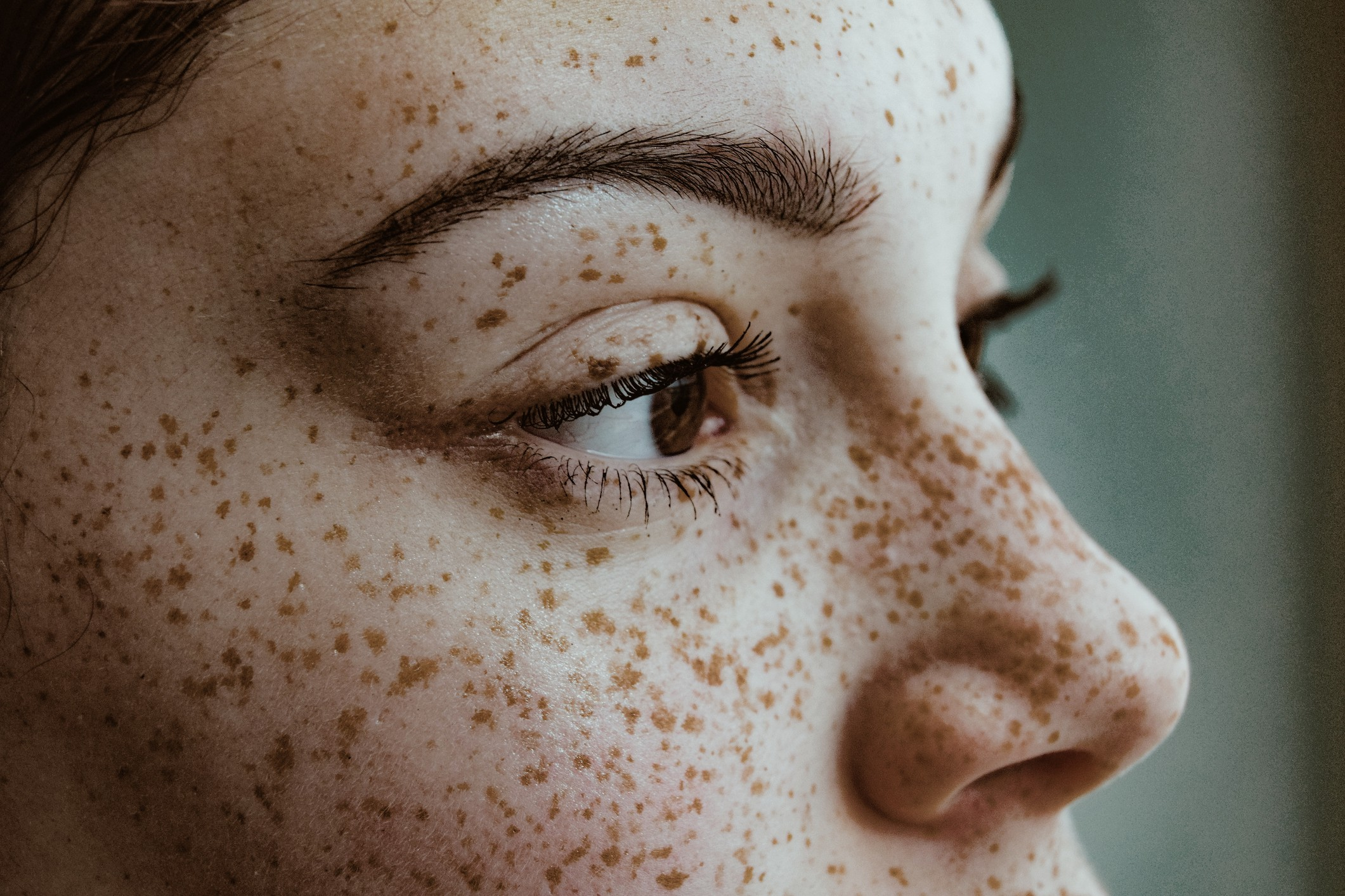 Closeup of woman's face with freckles.