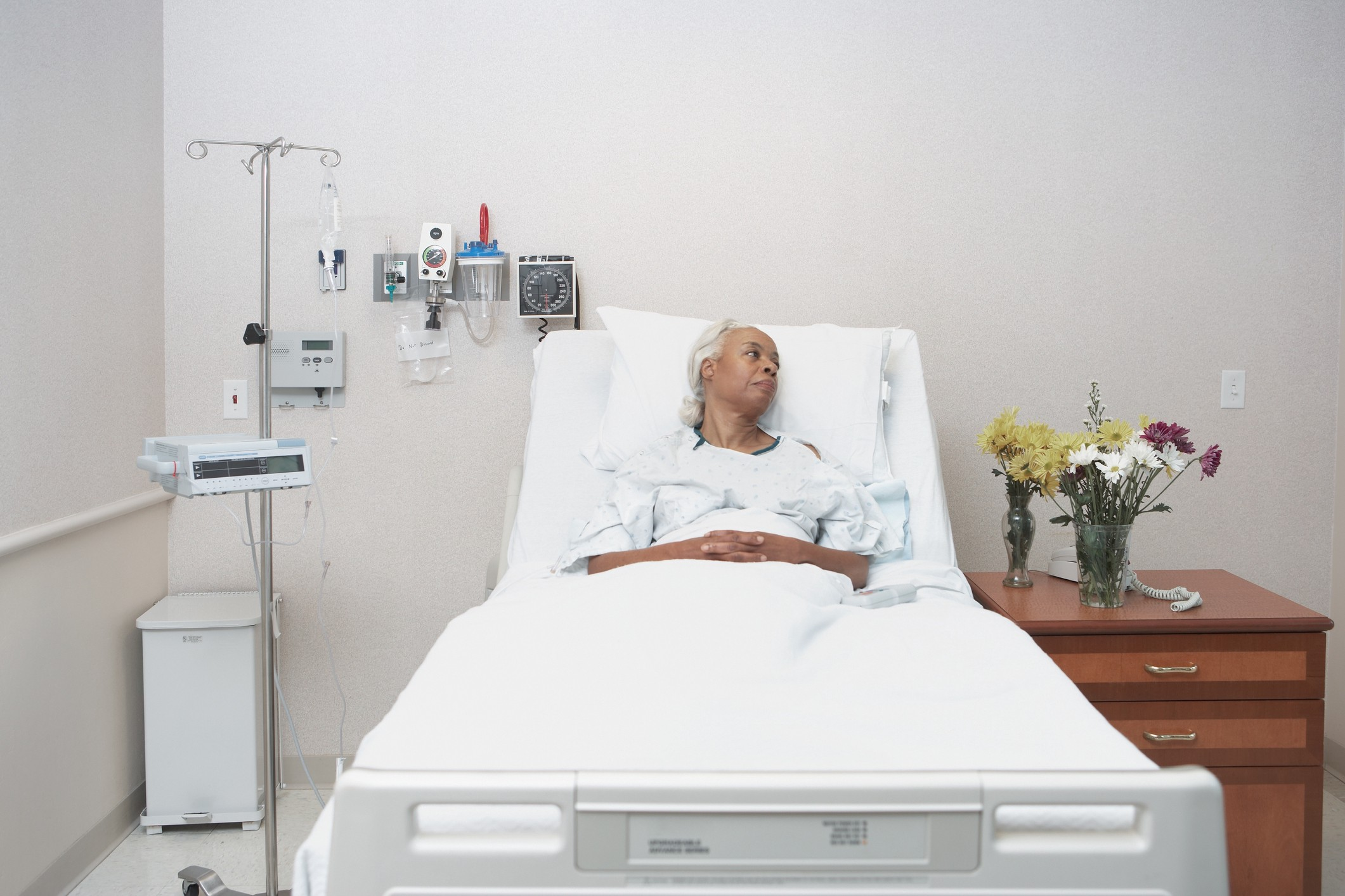 An elderly Black woman as a patient at the hospital.