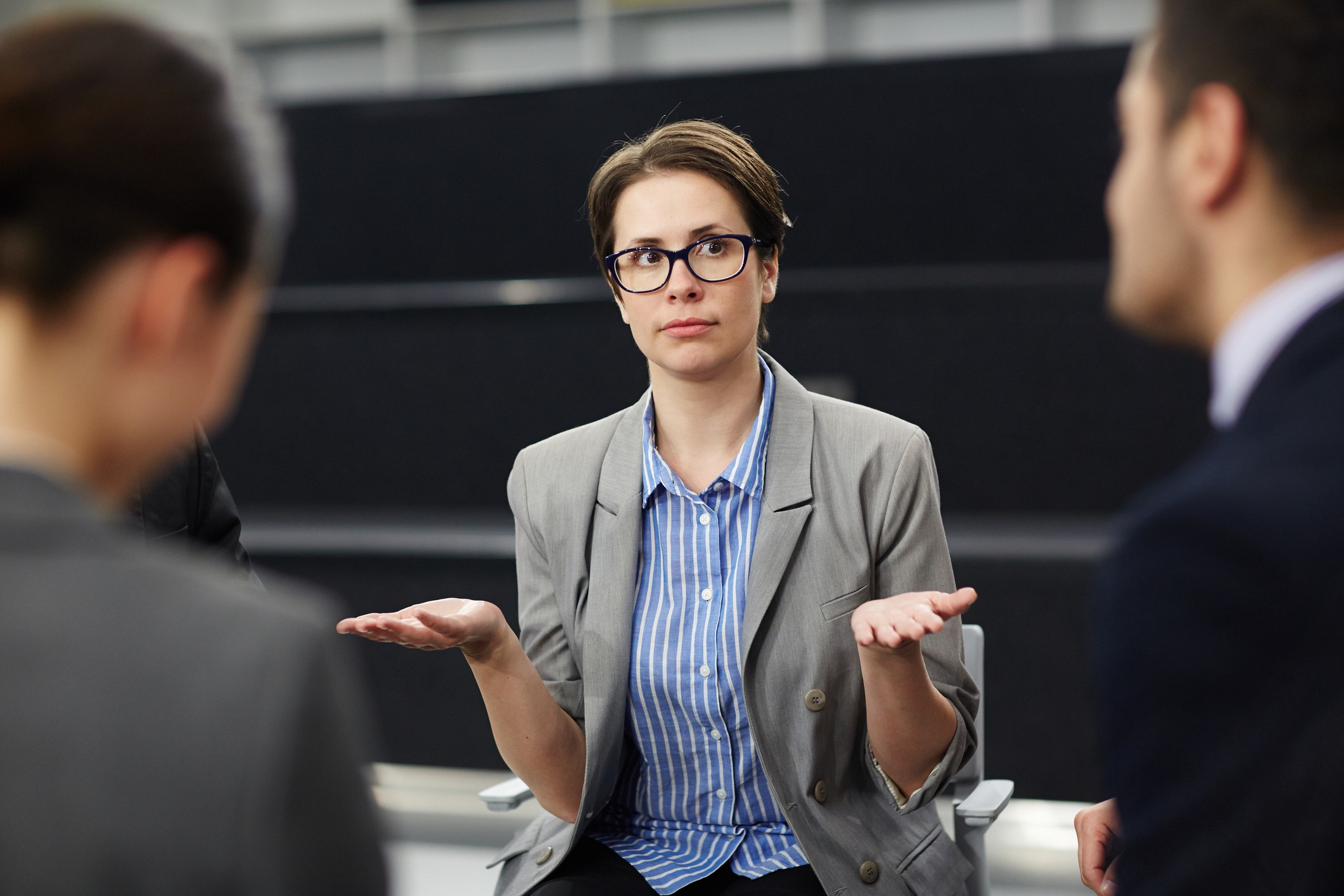 Business woman gesturing uncertainty.