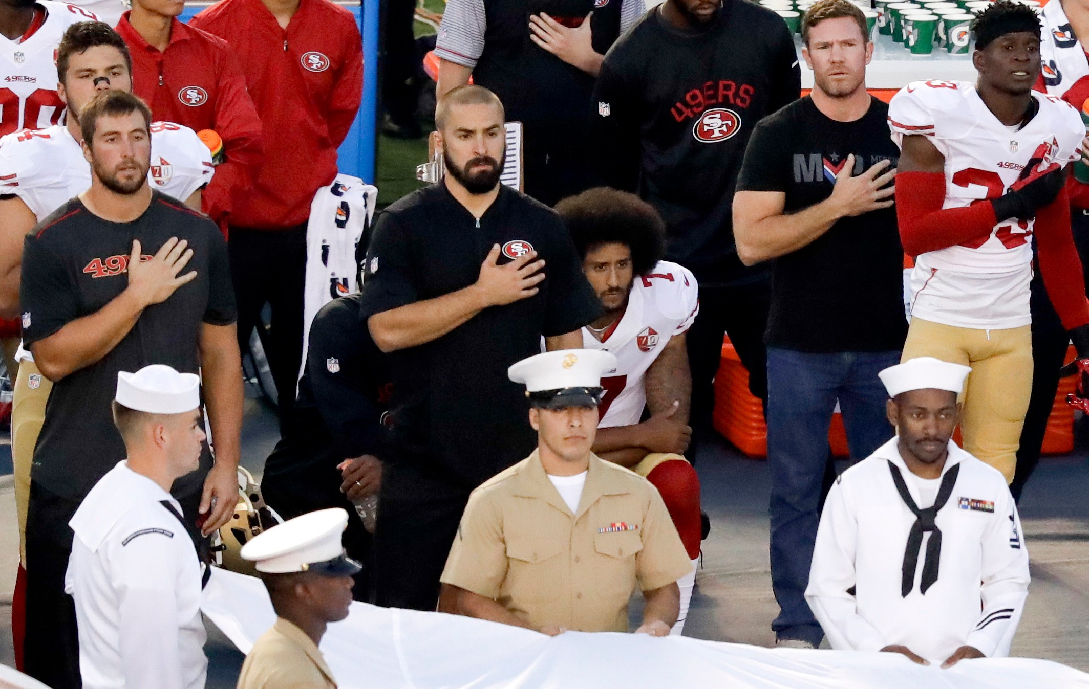 e761bc9d24cf Colin Kaepernick's choice not to stand for the national anthem is a clear  sign of protest. (AP Photo/Chris Carlson)