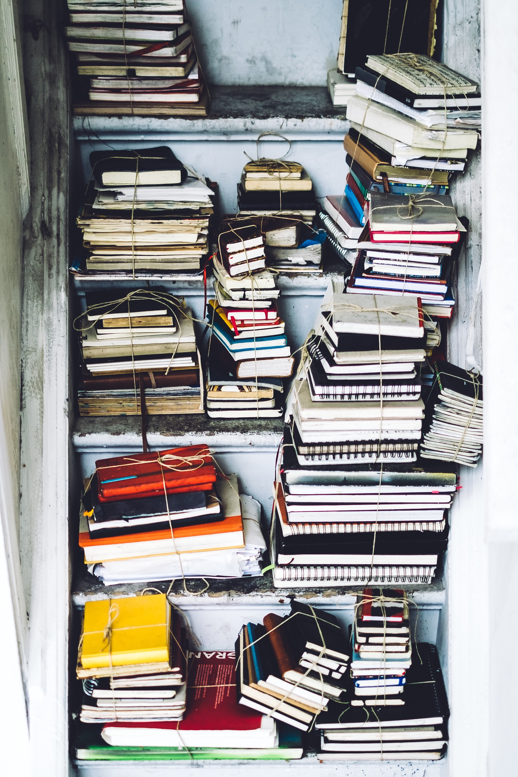 a closet full of spiral notebooks