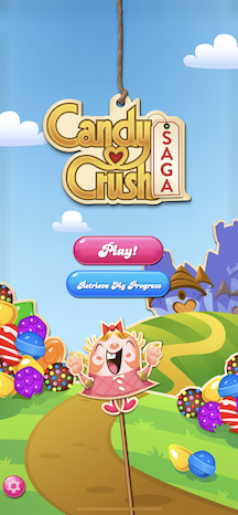"""Candy Crush's main menu superimposes 2 buttons (""""Play"""" and """"Progress"""") over a colorful candy road leading to a purple castle."""