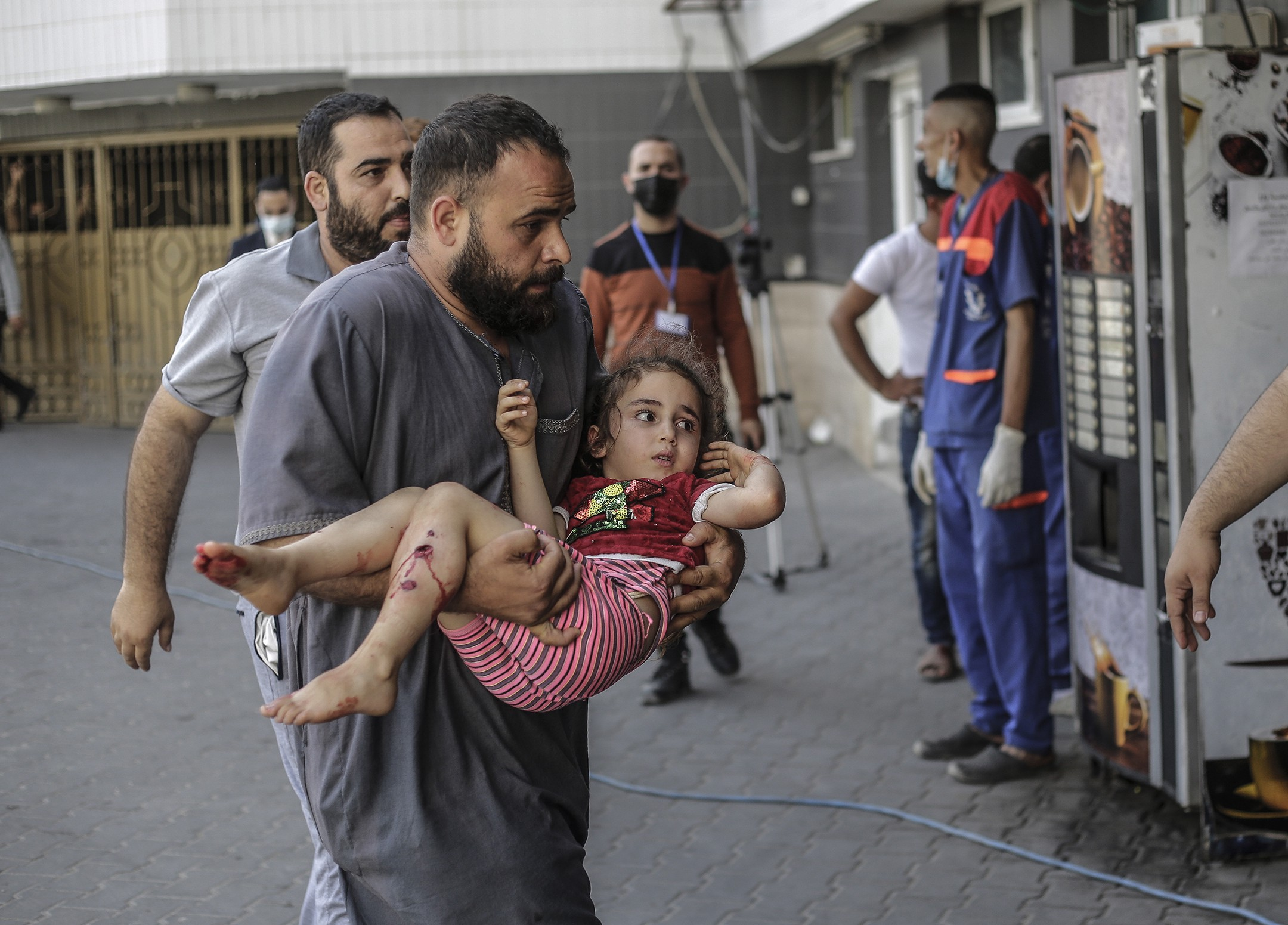 A wounded Palestinian girl is being brought to Shifa Hospital to receive treatment—12 May 2021. (Photo by Mahmoud Issa / SOPA Images/Sipa USA)(Sipa via AP Images).