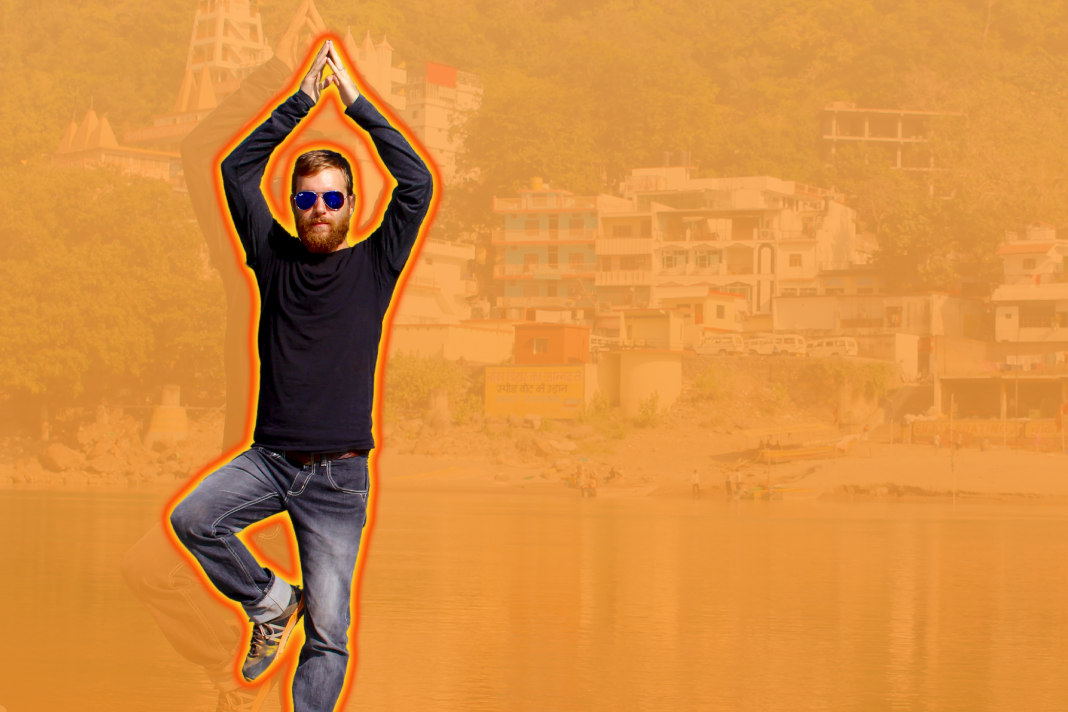 Man doing a tree pose in front of an orange background