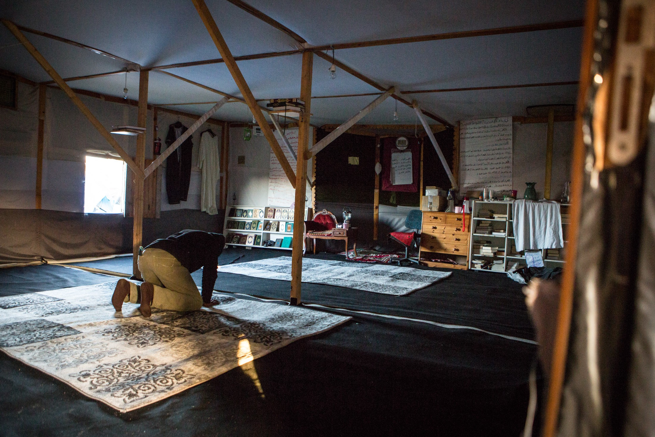 The doors are always open at houses of worship in the Jungle. In the makeshift mosques, new arrivals are given sanctuary for a night, then receive donated tents and sleeping bags to erect their own shelters.
