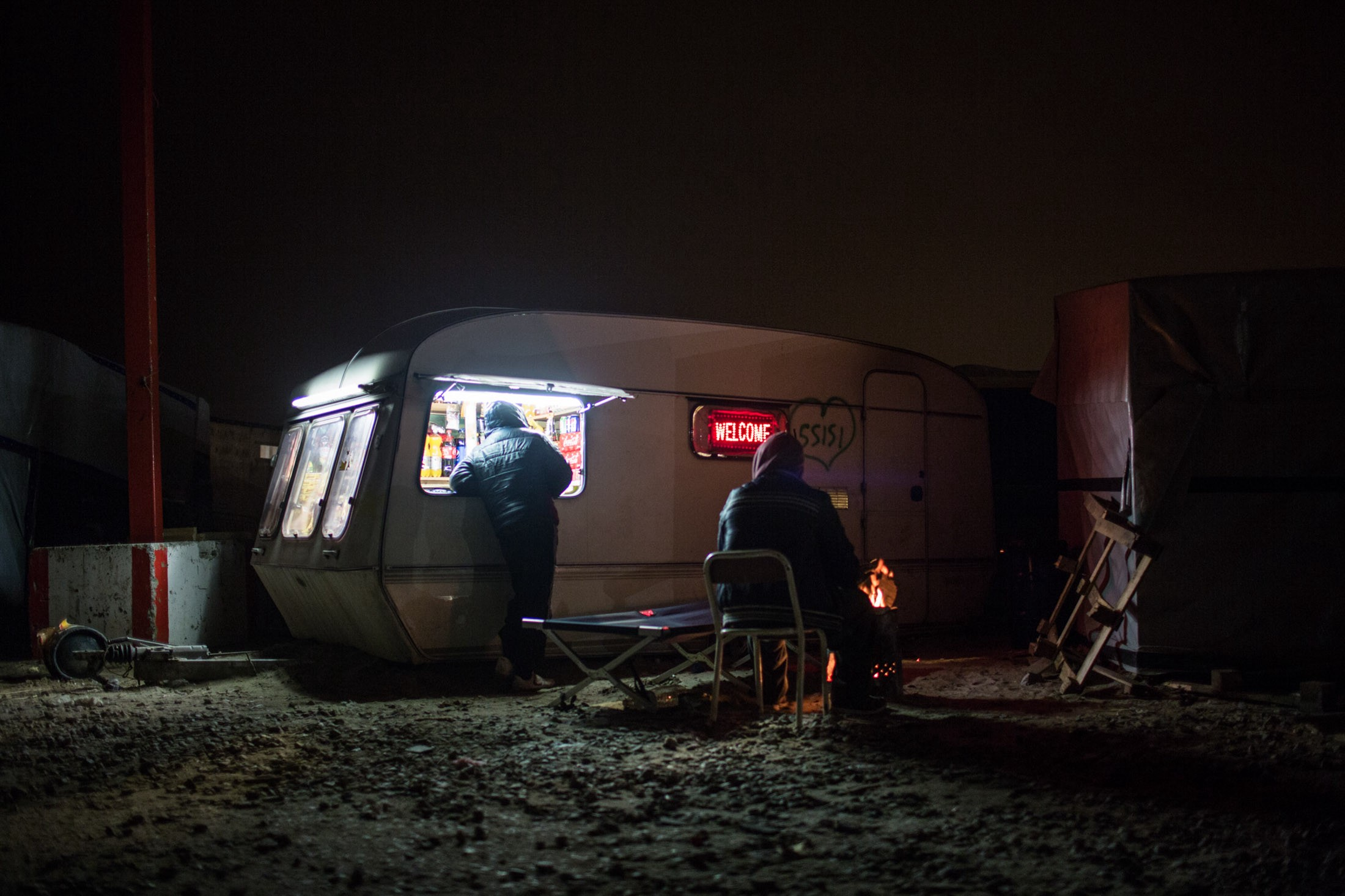 In this squalid encampment outside Calais, where food security is in jeopardy, refugees survive on donations cooked in communal kitchens or distributed by grassroots volunteer organizations striving to provide enough to eat.