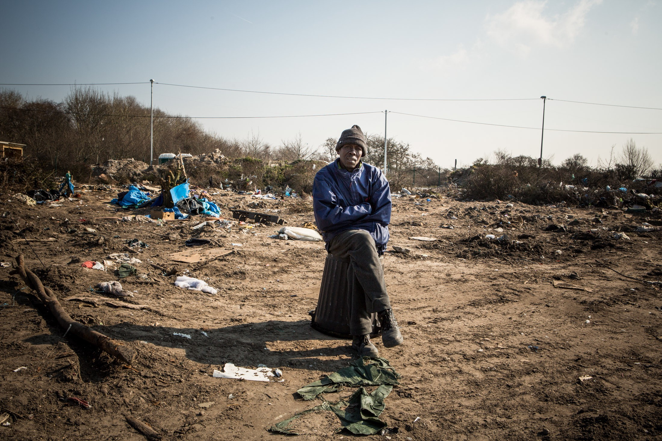 Abo Alraiga at the point in the Jungle where his house was located before authorities demolished the southern half of the encampment on the outskirts of Calais, violently displacing thousands of refugees in the process.