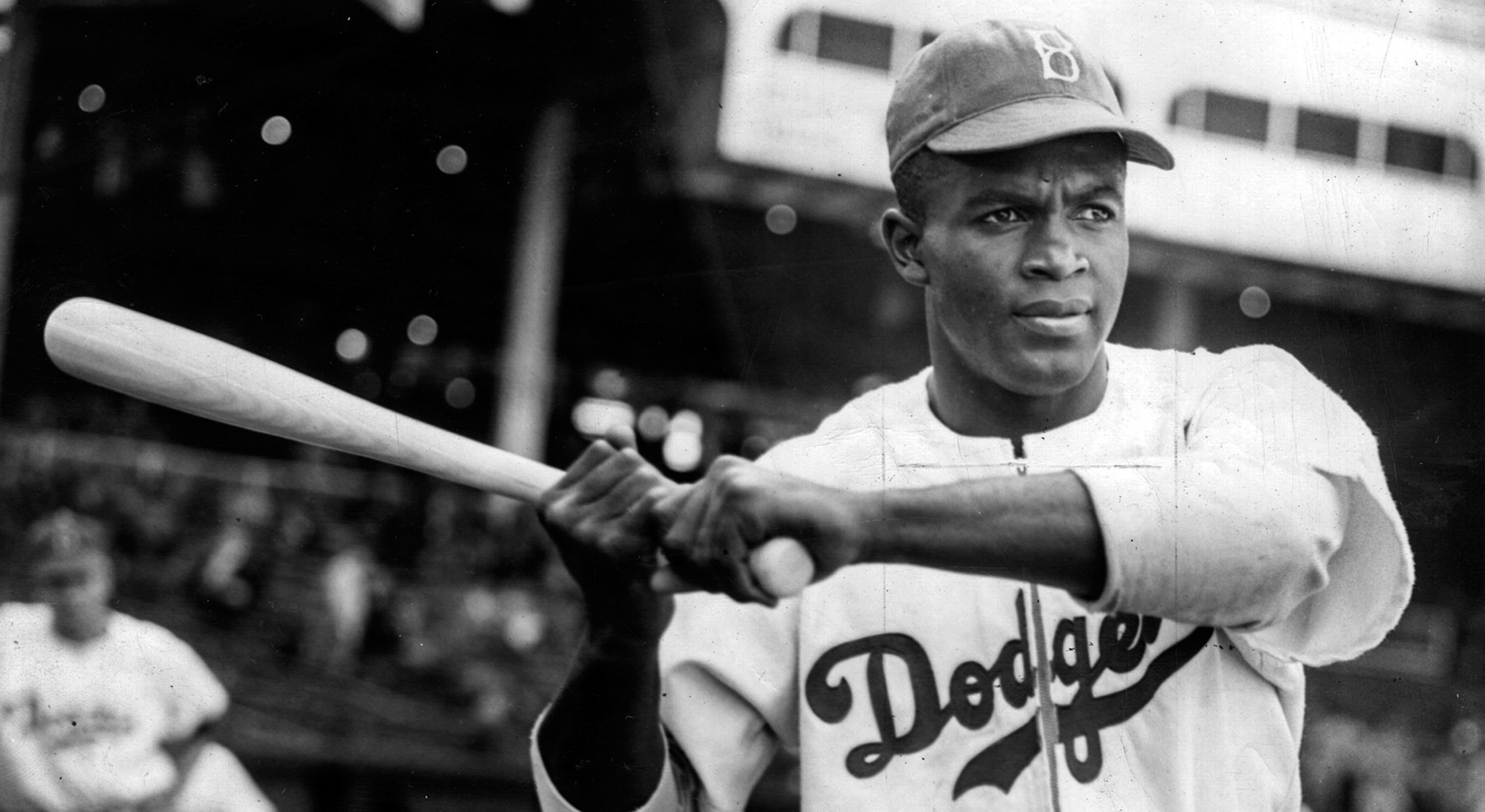 Jackie Robinson, famous Civil Rights activist and baseball player, at the plate in a Brooklyn Dodgers jersey