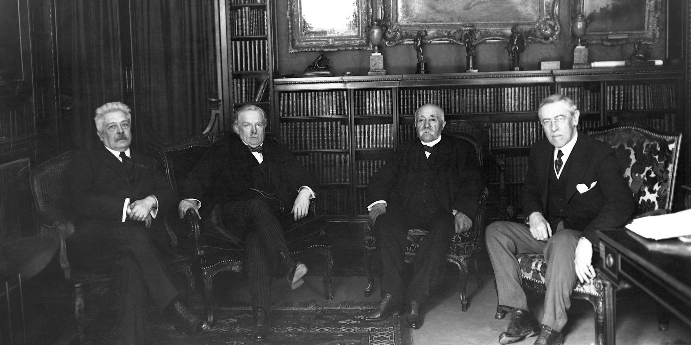 Vittorio Orlando, David Lloyd George, Georges Clemenceau, and Woodrow Wilson meet to discuss the Treaty of Versailles