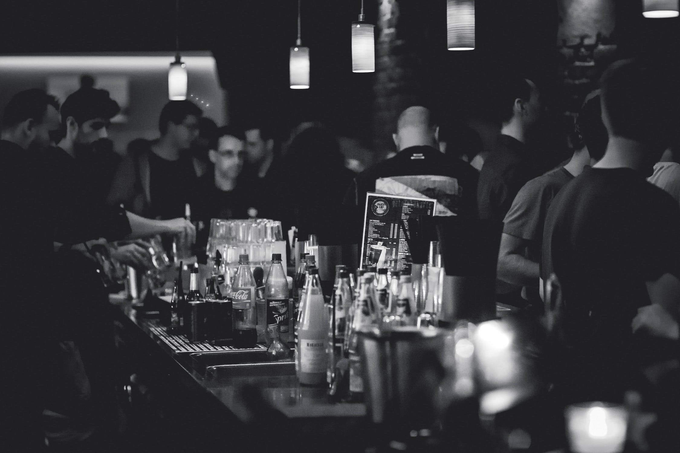 A black and white photo of a crowded bar