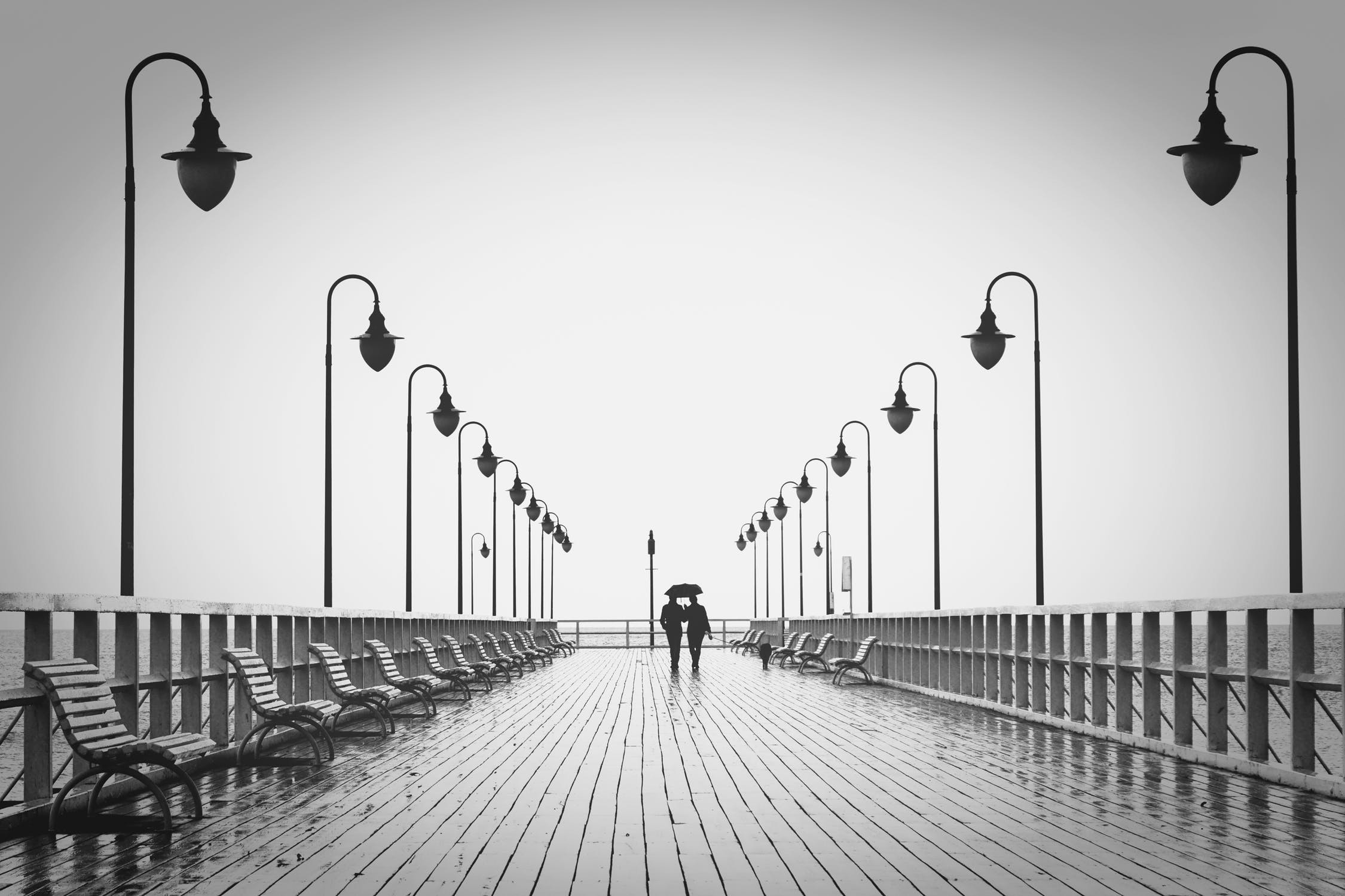 """""""If we can realize this, we can be ever so grateful to our deceased friend."""" A couple walking in the rain. Source: Pixabay"""