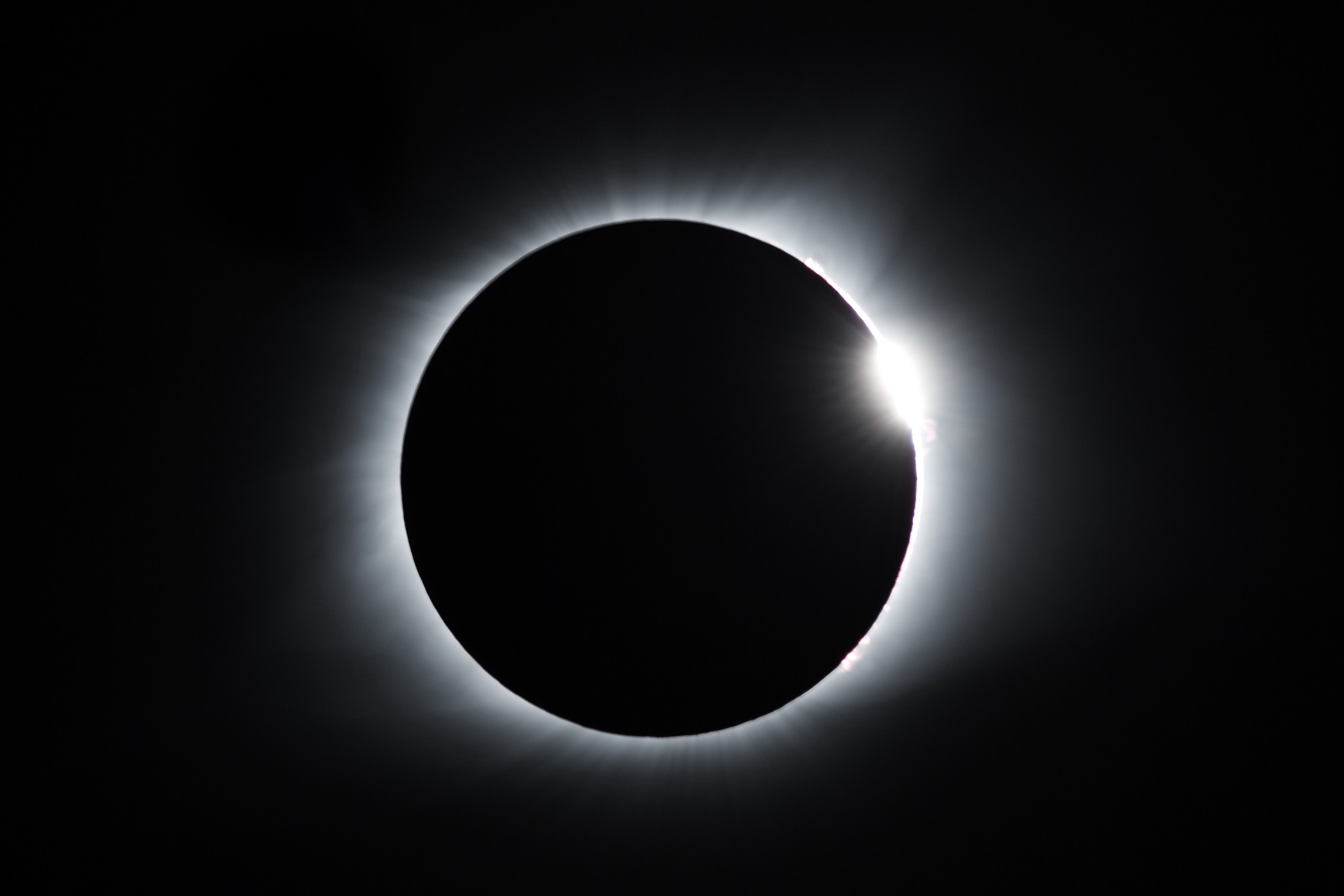 Black sky with a total eclipse.