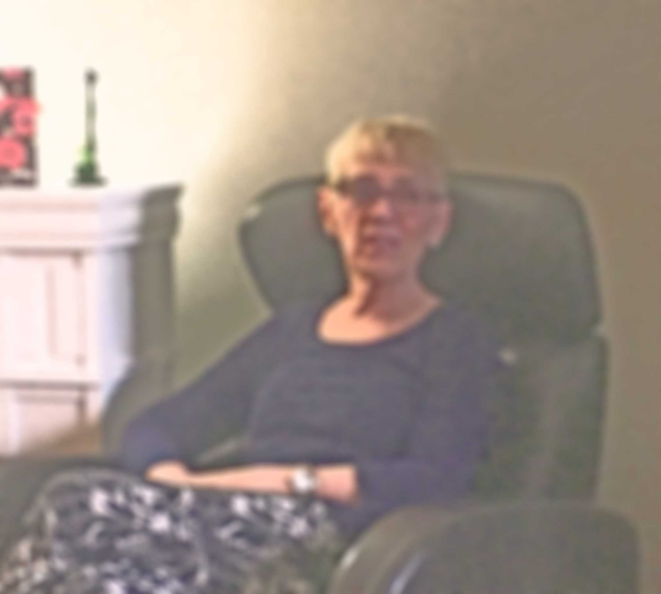 Faded, blurry photo of a woman with Alzheimer's disease.
