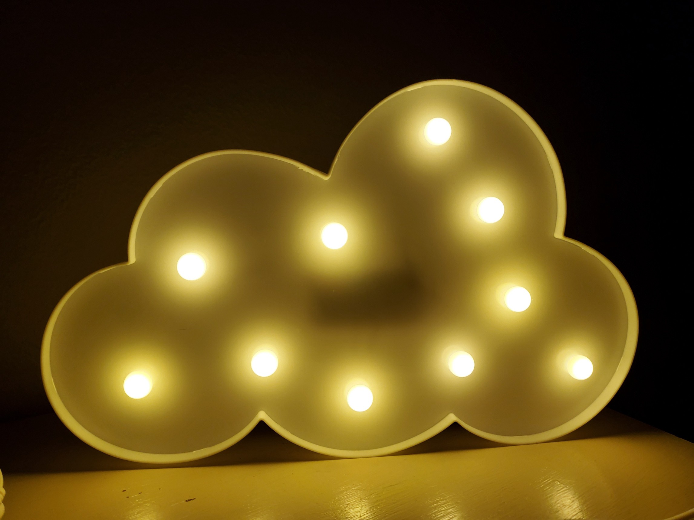 The cloud-shaped night light in our foster child's room.