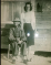 My Granny's father, William Qualls sitting in a chair in overalls, and her sister, Ethel Mae standing behind him.