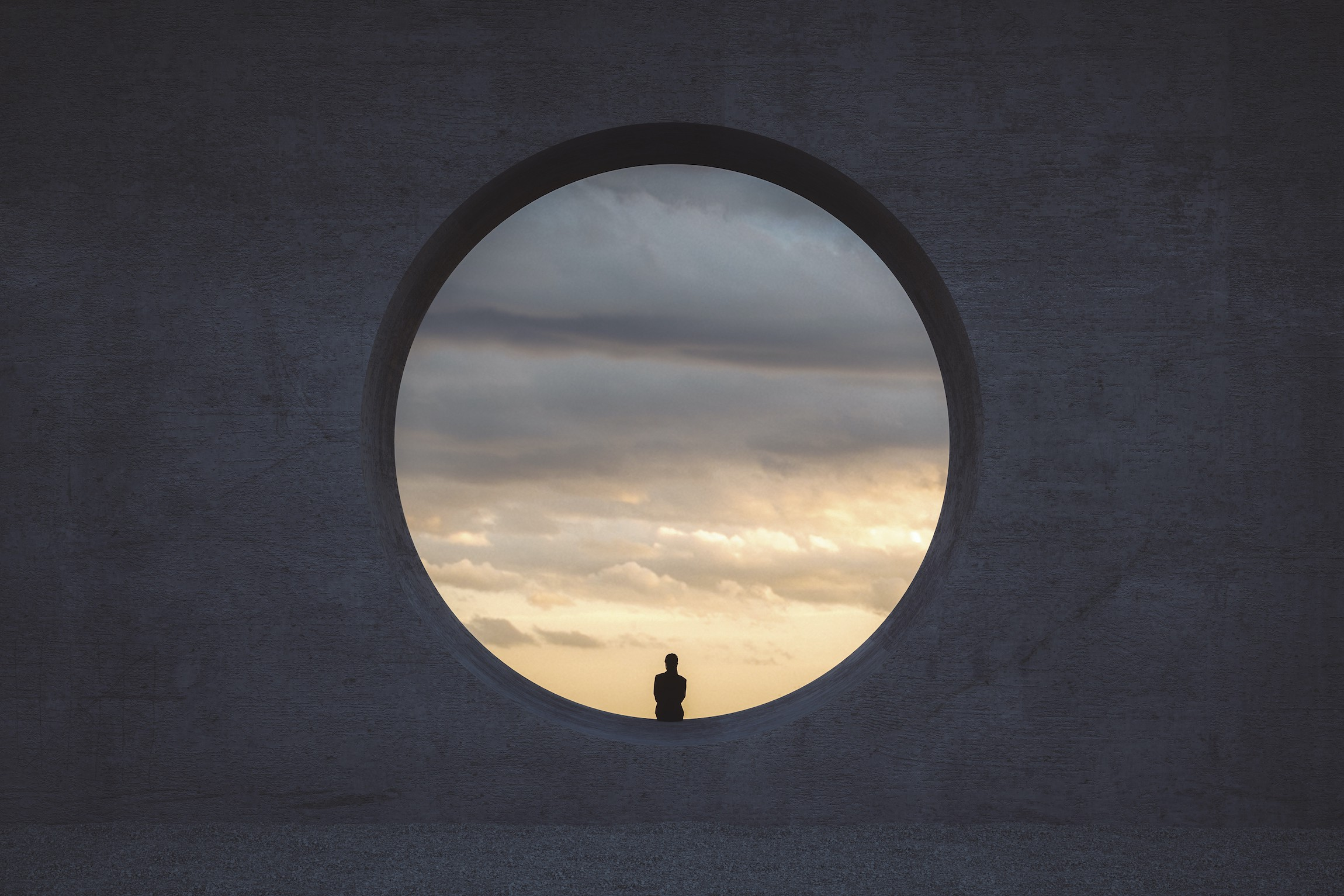 A person looking at a cloudy sky, sitting in a circular window that's almost 10 times taller than them.