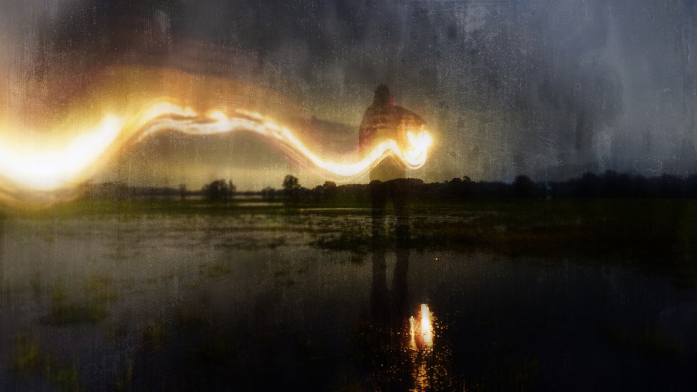 Watercolor-like double exposure photo of a person making light design in a dark atmosphere.