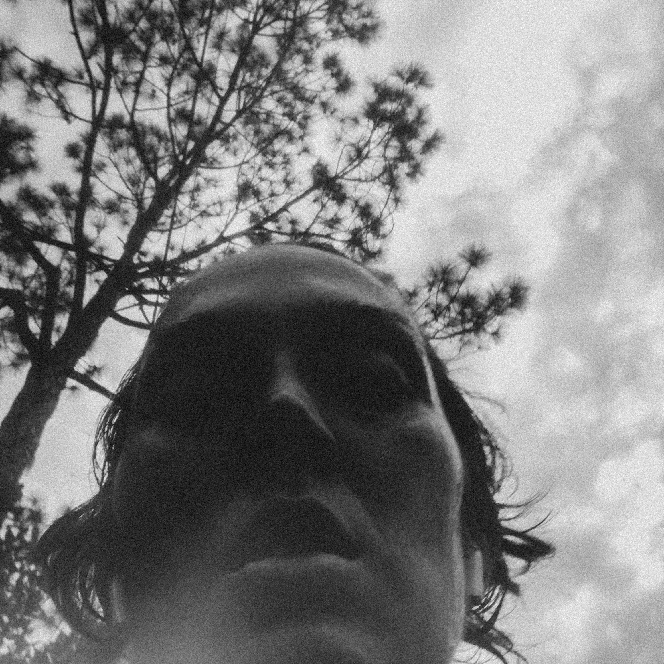 Black and white self-portrait, looking up, dark shadows on my face. A bit sweaty and serious as I've been running.