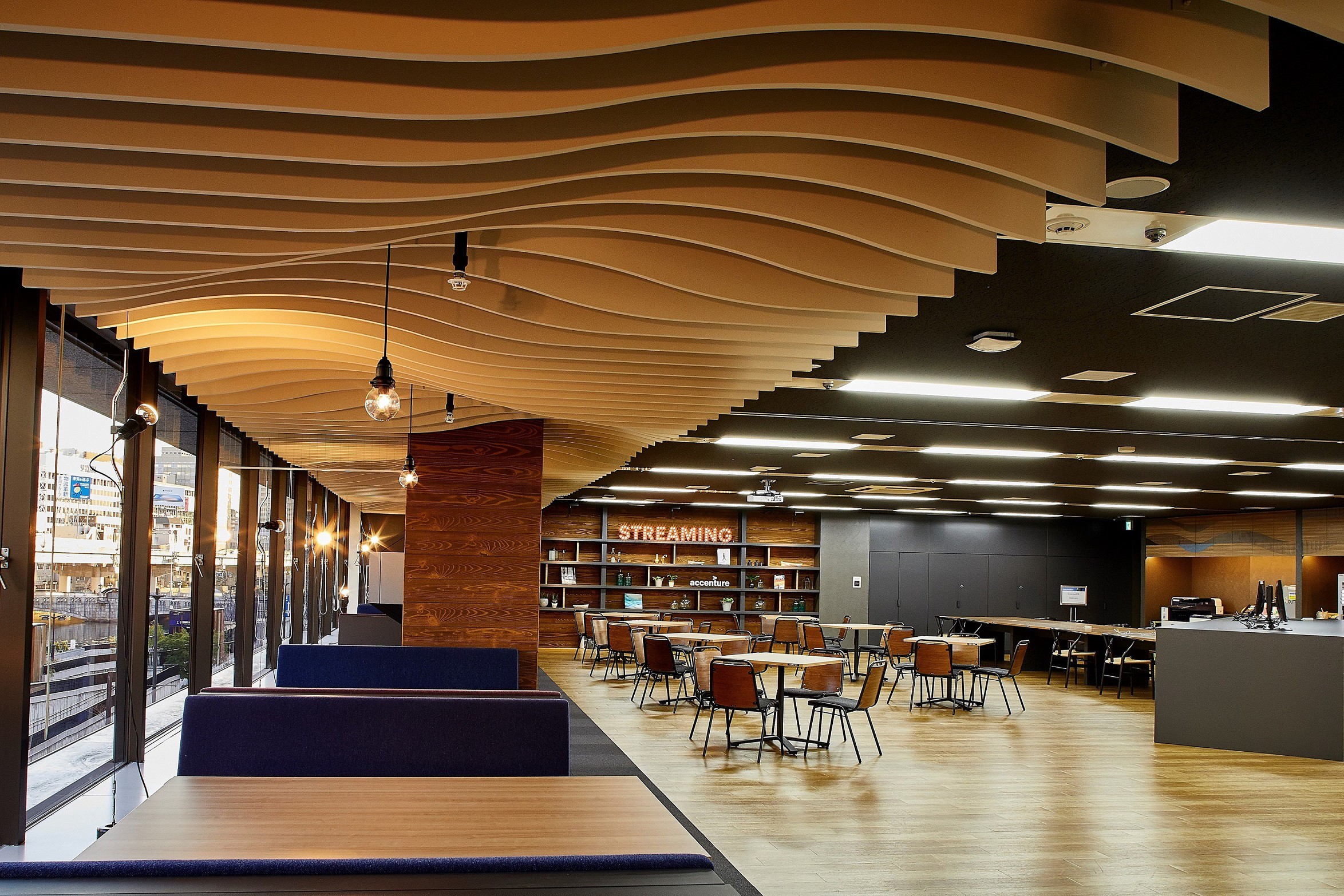 Interiors of one of Accenture's global offices featuring a social space