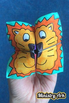 """folded paper """"fortune teller"""" with the face of a lion"""