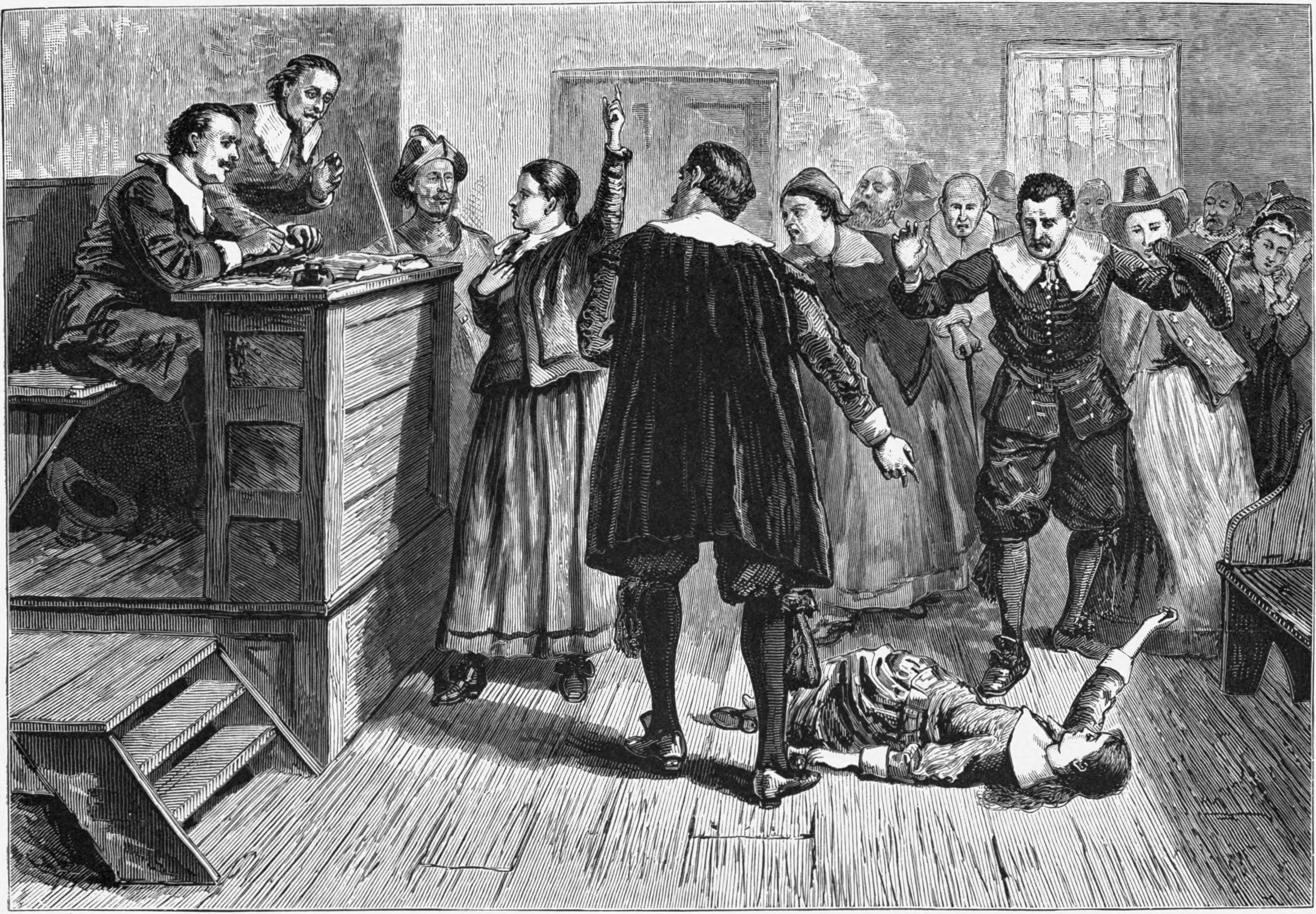 Salem witch trials: a girl lays on the ground as a courtroom full of people point and gesture.