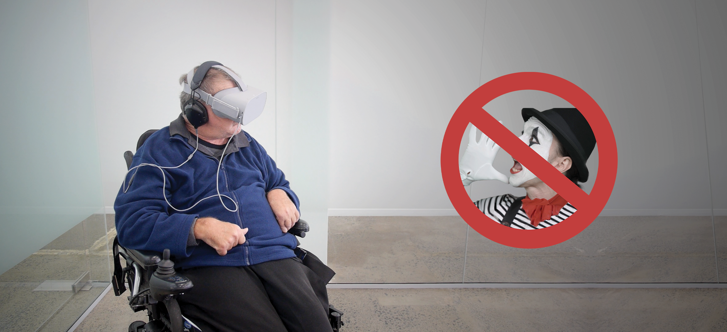A man in a wheelchair wearing a VR headset next to the Talking Mimes logo (like a no smoking sign, but with a mime yelling)