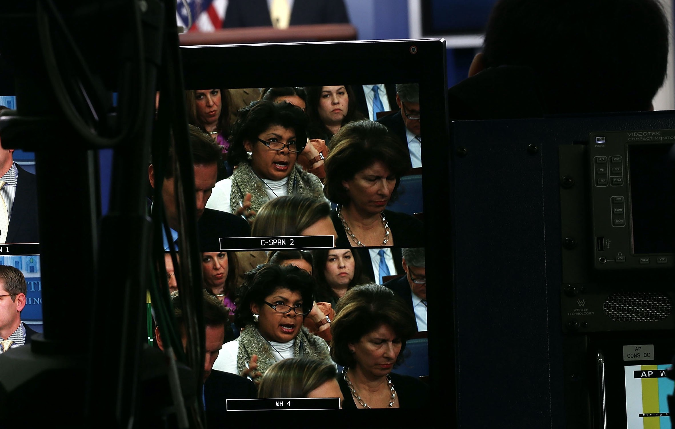 April Ryan, seen on a TV monitor, asking questions in the White House press briefing room.