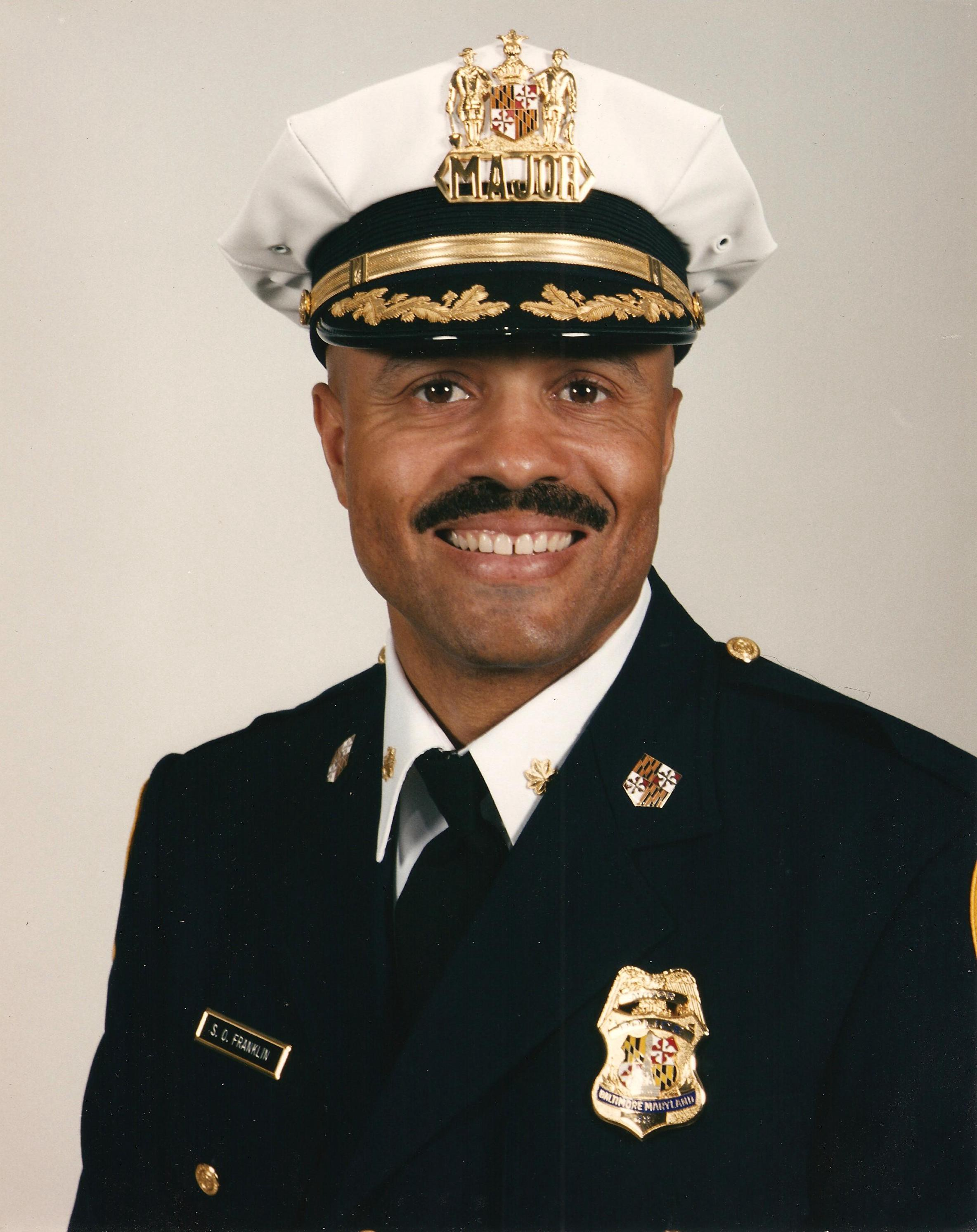 A formal headshot of a Major Franklin in a police uniform.