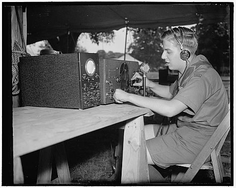The same ionosphere that allows this Boy Scout to use shortwave radio in 1937 prevents Earth-bound astronomers from seeing light from the first stars in the Cosmos. Image credit: Public domain/Harris and Ewing, photographers.
