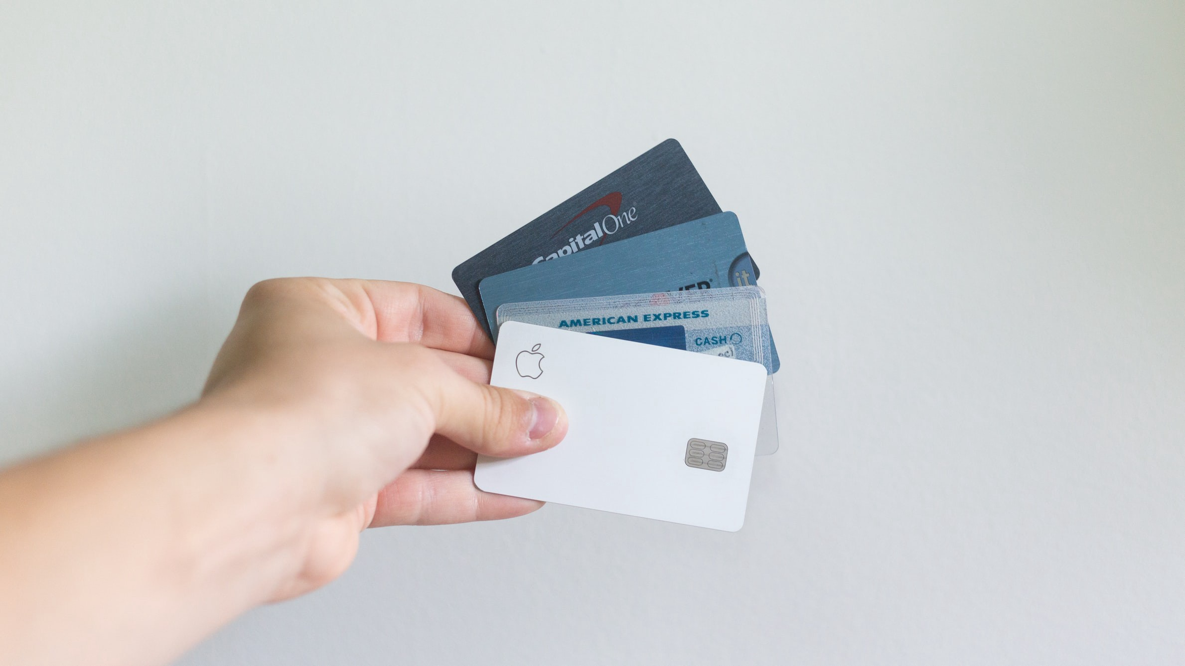 A hand fanning out credit cards.