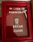 "Picture of gag gift featuring a hammer and a packet of ketchup behind glass with ""emergency break glass"" written on it."