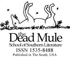 Dead mule with legs in the air.