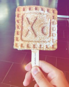 Picture of my humble hand holding a wonderful waffle featuring the Adobe Xd logo