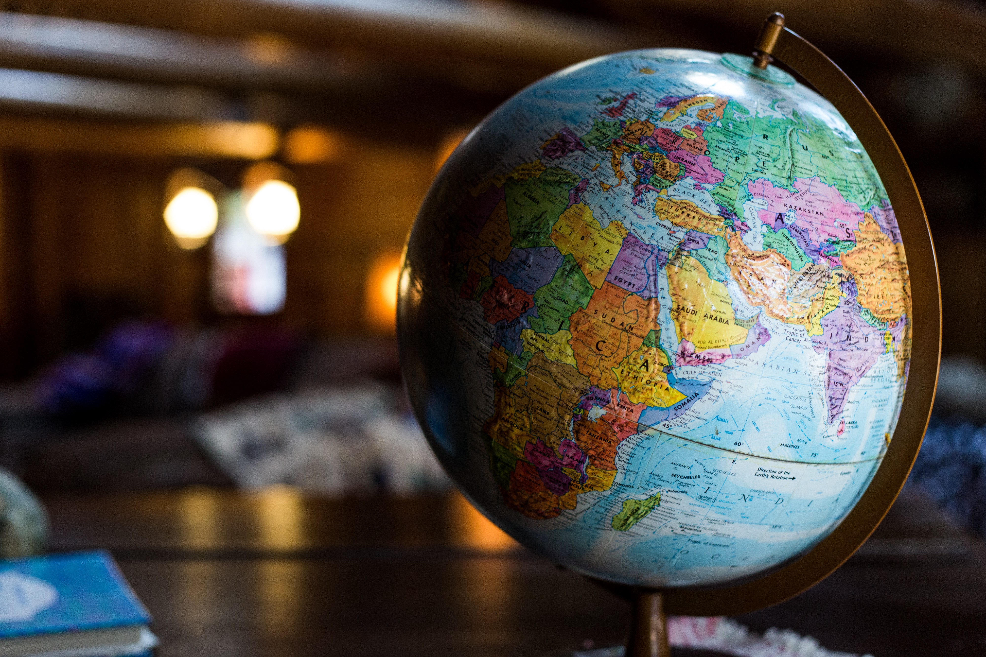 A globe on a table in a library