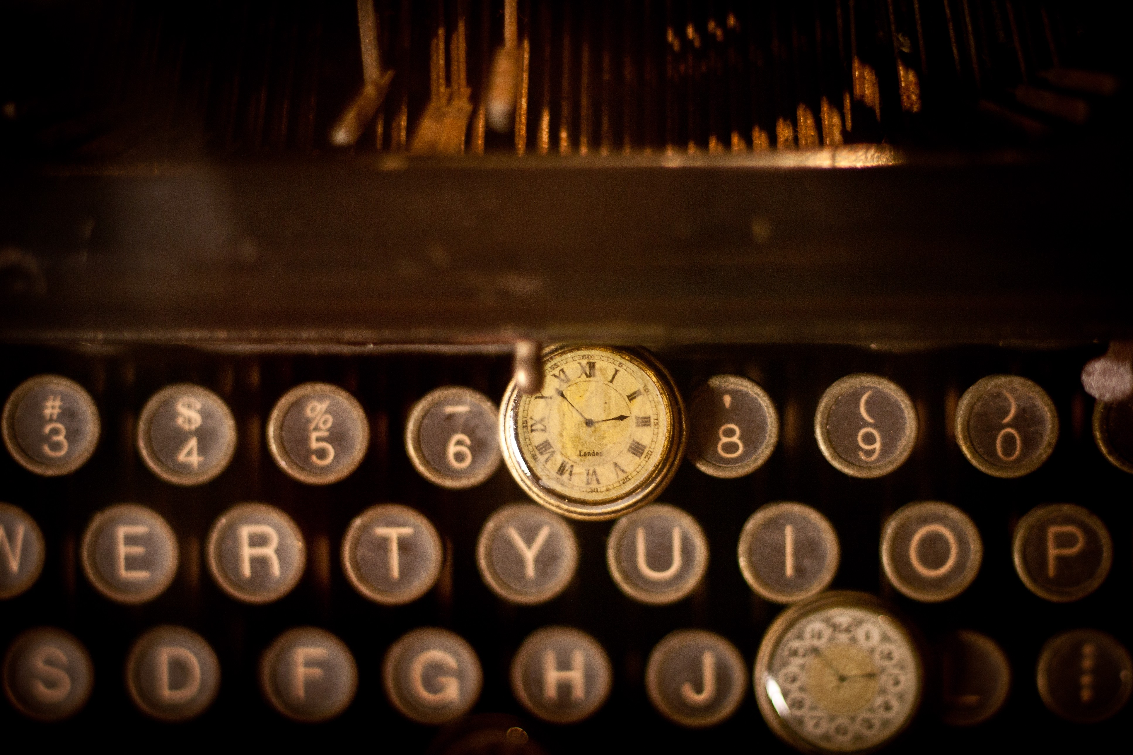 An image of the keys on an old typewriter, and an old clock on top of the keys, to go with my post about the Blogable Fiction Marathon.