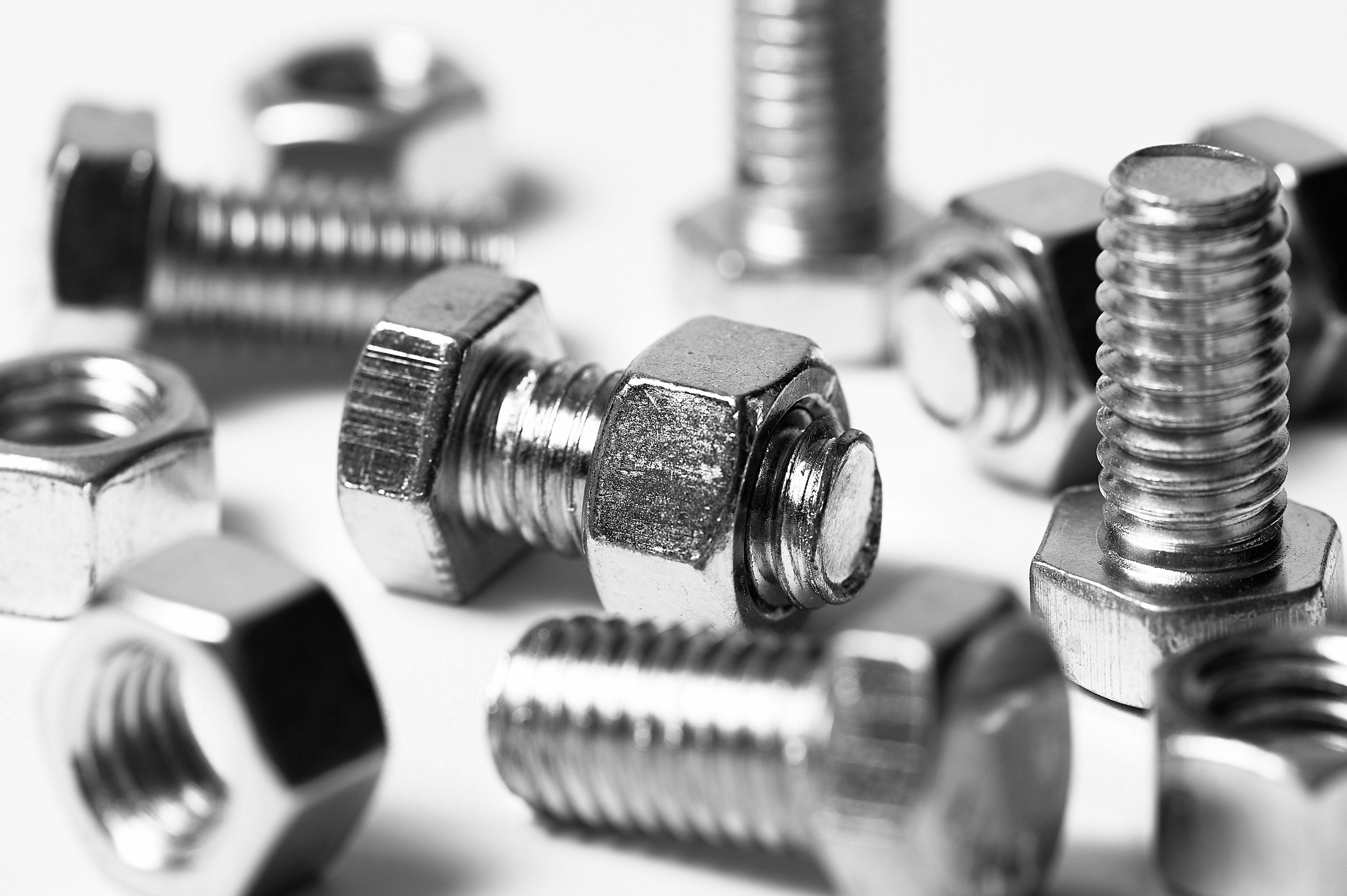 A black and white image of nuts and bolts to go with the next part of the series called 'Thirteen Years'.